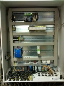 5. interior of the new CO2 control panel which houses the PLC, HMI relays and power supply unit